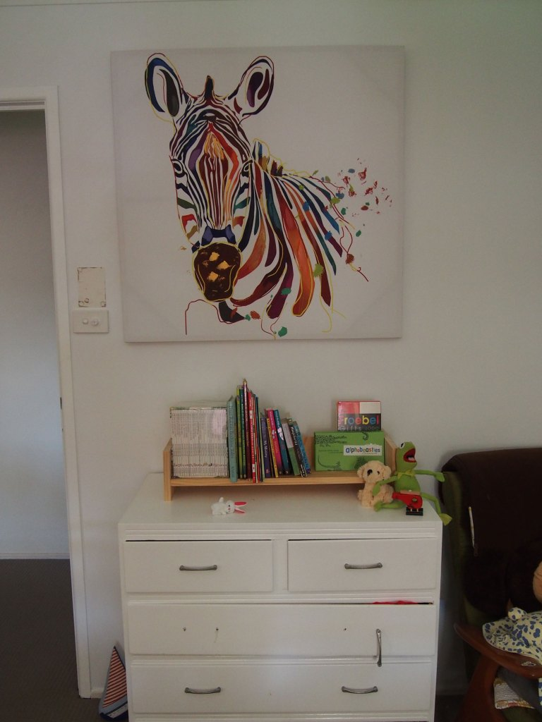 Photo of chest of drawers with small book shelf