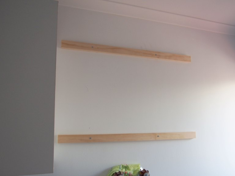 Two pine battens, attached to the studs with 8g, 50mm screws